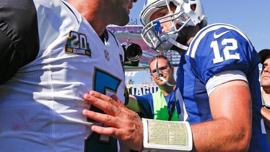 Indianapolis Colts quarterback Andrew Luck (12) greets Jacksonville Jaguars quarterback Blake Bortles, left, after an NFL football game in Jacksonville, Fla., Sunday, Sept. 21, 2014. Indianapolis won 44-17. (AP Photo/Stephen B. Morton)