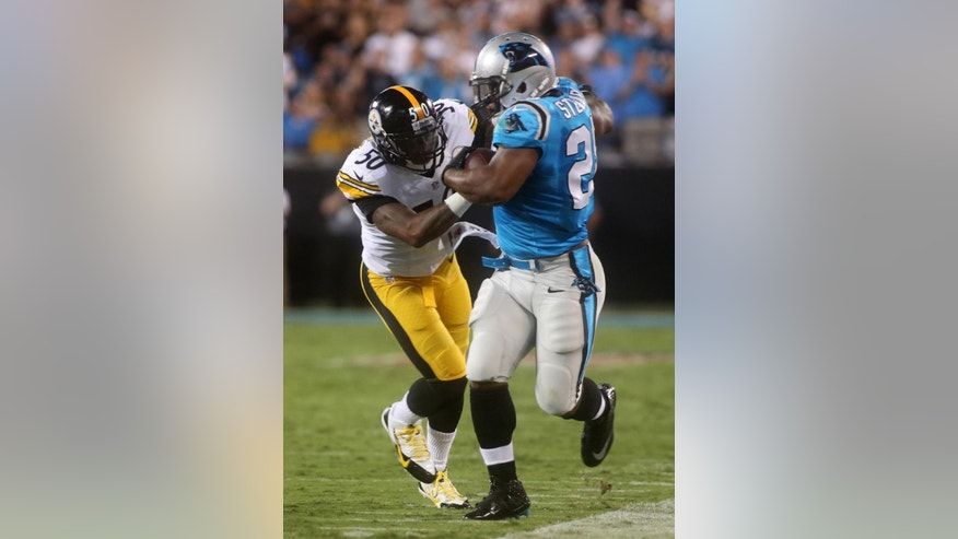 Carolina Panthers' Jonathan Stewart (28) is forced out of bounds by Pittsburgh Steelers' Ryan Shazier (50) during an NFL football game Sunday, Sept. 21, 2014, in Charlotte, N.C. (AP Photo/The Star, Ben Earp)