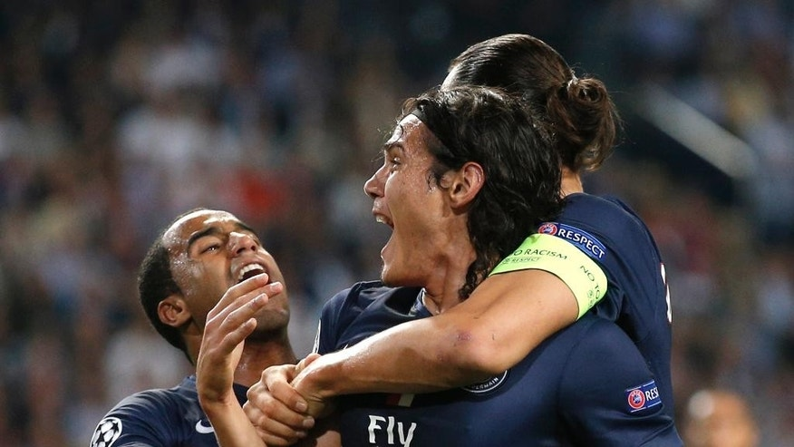PSG's Edinson Cavani, center, reacts after scoring the opening goal, with PSG's Zlatan Ibrahimovic, right, and PSG's Lucas during the Group F Champions League match between Ajax and Paris Saint-Germain at ArenA stadium in Amsterdam, Netherlands, Wednesday, Sept. 17, 2014. (AP Photo/Peter Dejong)