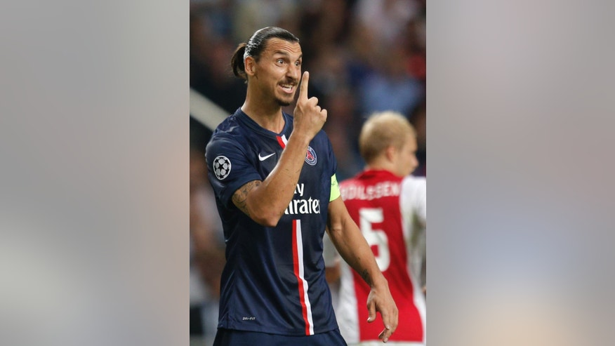 PSG's Zlatan Ibrahimovic gestures during the Group F Champions League match between Ajax and Paris Saint-Germain at ArenA stadium in Amsterdam, Netherlands, Wednesday, Sept. 17, 2014. (AP Photo/Peter Dejong)