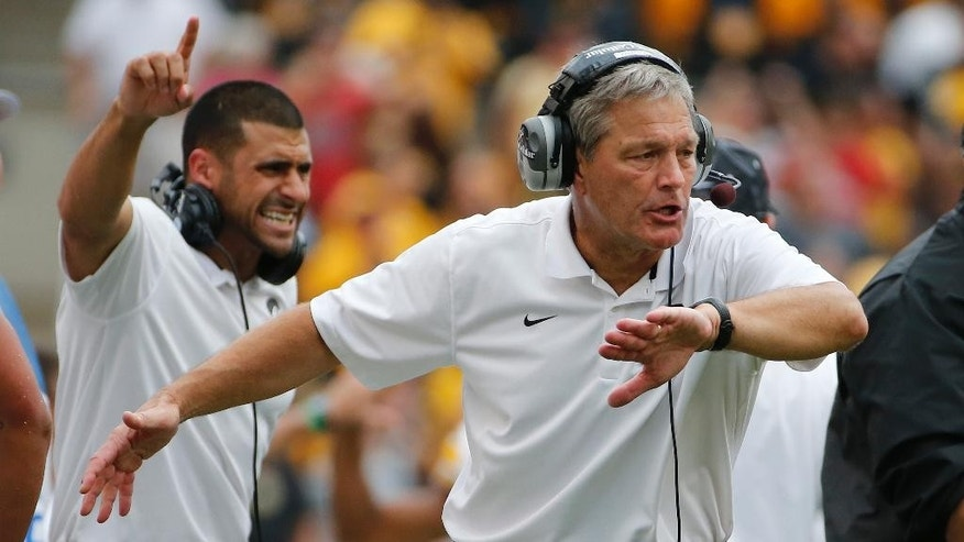 Iowa head coach Kirk Ferentz, right, celebrates as his defense comes off the field after stopping a Pitt drive during the fourth quarter of an NCAA college football game in Pittsburgh, Saturday, Sept. 20, 2014. Iowa won 24-20. (AP Photo/Gene Puskar)