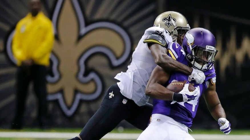 Minnesota Vikings wide receiver Cordarrelle Patterson (84) is tackled by New Orleans Saints cornerback Keenan Lewis (28) in the second half of an NFL football game in New Orleans, Sunday, Sept. 21, 2014. (AP Photo/Bill Haber)