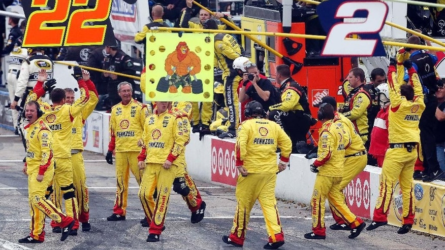 Joey Logano's crew celebrates after he won the NASCAR Sprint Cup Series Sylvania 300 at New Hampshire Motor Speedway, Sunday, Sept. 21, 2014, in Loudon, N.H. (AP Photo/Jim Cole)