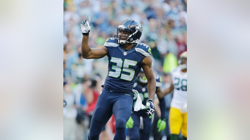 FILE - In this Sept. 4, 2014, file photo, Seattle Seahawks defensive back DeShawn Shead gestures in the first half of an NFL football game in Seattle. Shead won twice on Sunday, Sept. 21, 2014.  First, Shead participated on special teams and defense in Seattle's 26-20 overtime win over the Denver Broncos. And after the game, Shead proposed to his girlfriend, Jessica Martinez, on the field.  (AP Photo/Scott Eklund, File)