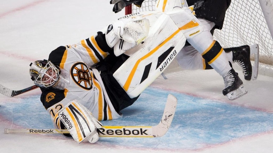 Boston Bruins goalie Niklas Svedberg (72) is run over by teammate Kevan Miller during the second period of an NHL pre-season hockey game, Tuesday, Sept. 23, 2014 in Montreal. (AP Photo/The Canadian Press, Ryan Remiorz)