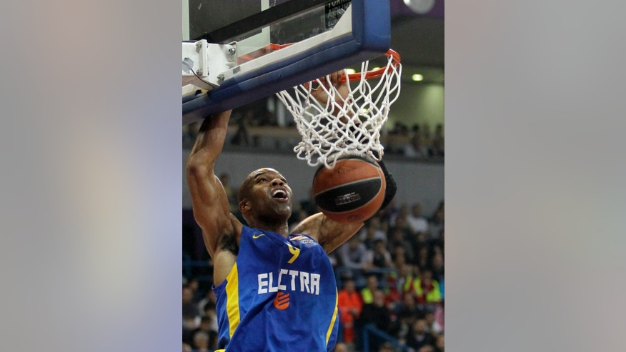 FILE - In this Thursday, March 20, 2014 file photo, Alex Tyus of Israel's BC Maccabi Electra dunks a ball during their Euroleague Top 16 basketball match against Partizan, in Belgrade, Serbia, Thursday, March 20, 2014. With his Maccabi Tel Aviv team set to face LeBron James in his first game back for the Cleveland Cavaliers on Oct. 5, 2014, Alex Tyus, a 6-9 power forward from St. Louis, has an important decision to make _ whether to fast the previous day for the Jewish holy day of Yom Kippur. American Jews have long found a basketball refuge in Israel but the Jewish state has never seen anything like Tyus before: an African-American standout from a major college program with no previous link to the religion who decided, along with his future wife, to embrace the faith and set off on a path that led him to the Israel national team and the best team in the country. (AP Photo/Darko Vojinovic, File)