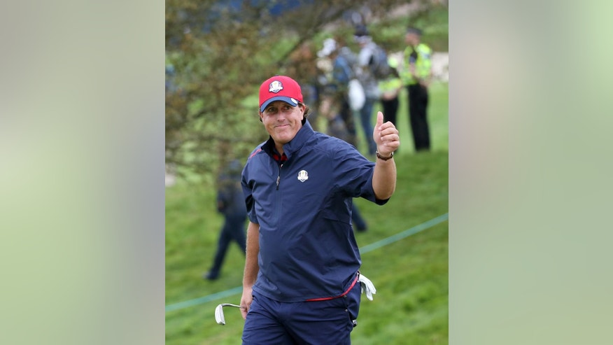 Phil Mickelson of the US gestures as he walks to the 7th green during a practice round ahead of the Ryder Cup golf tournament at Gleneagles, Scotland, Tuesday, Sept. 23, 2014. (AP Photo/Scott Heppell)