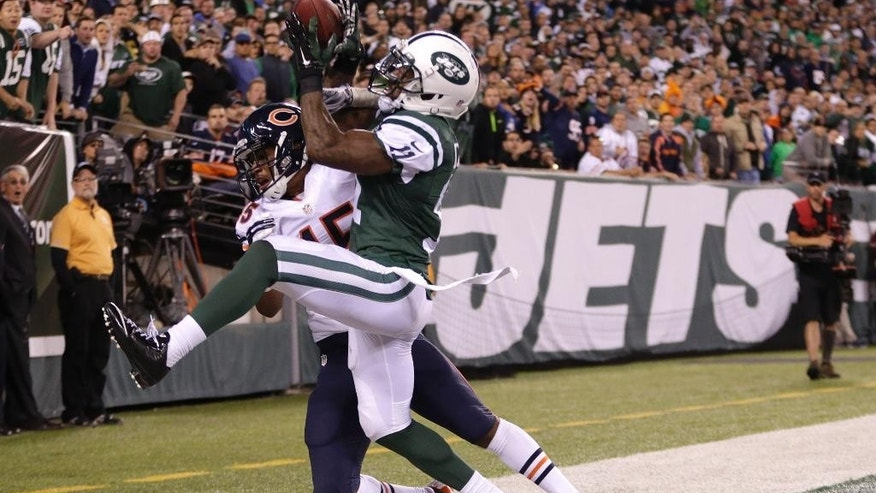 New York Jets wide receiver Jeremy Kerley (11) comes down with a pass out of bounds from the end zone as Chicago Bears strong safety Brock Vereen (45) defends during the fourth quarter of an NFL football game, Monday, Sept. 22, 2014, in East Rutherford, N.J. The Bears won 27-19. (AP Photo/Julio Cortez)