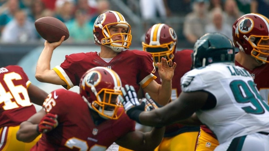 Washington Redskins' Kirk Cousins passes during the first half of an NFL football game against the Philadelphia Eagles, Sunday, Sept. 21, 2014, in Philadelphia. (AP Photo/Matt Rourke)