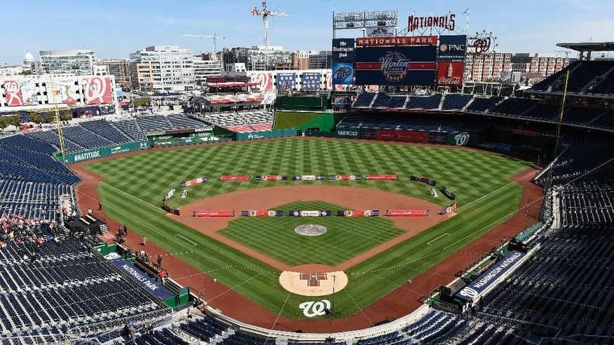 An outline for a hockey rink is shown on the field at Nationals Park in Washington, Tuesday, Sept. 23, 2014, where the 2015 Bridgestone WInter Classic hockey game will be played on Jan. 1, 2015, during the unveiling of the Washington Capitals uniforms. The Washington Capitals will play the Chicago Blackhawks in the game that will be played New Years Day at Nationals Park.  (AP Photo/Susan Walsh)