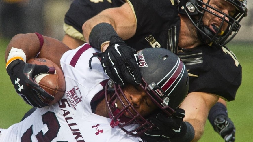 Purdue's Sean Robinson (10) brings down Southern Illinois' Malcom Agnew (31) during an NCAA college football game Saturday, Sept. 20, 2014, in West Lafayette, Ind. Purdue won 35-13. (AP Photo/The Journal & Courier, Michael Heinz ) MANDATORY CREDIT; NO SALES