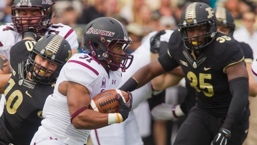 Southern Illinois' Malcom Agnew (31) looks for room as Purdue's Sean Robinson (10) and Ja'Whaun Bentley (35) close in during an NCAA college football game Saturday, Sept. 20, 2014, in West Lafayette, Ind. Purdue won 35-13. (AP Photo/The Journal & Courier, Michael Heinz ) MANDATORY CREDIT; NO SALES