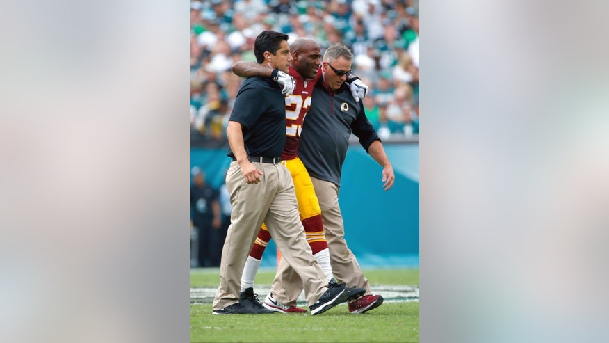 FILE - In this Sept. 21, 2014, file photo, Washington Redskins' DeAngelo Hall is helped off the field after an injury during the second half of an NFL football game against the Philadelphia Eagles in Philadelphia. The Washington defense is full of anomalies through three games, and now it must proceed without three-time Pro Bowl cornerback DeAngelo Hall.  (AP Photo/Matt Rourke, File)
