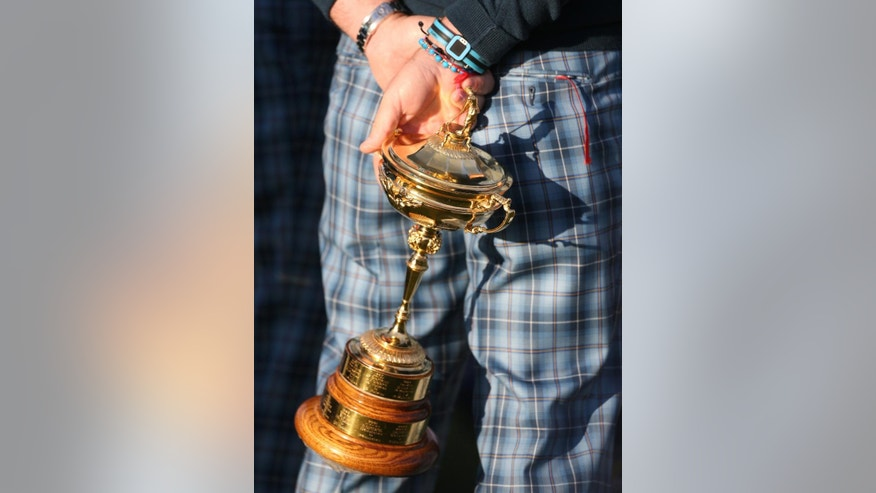 Europe team captain Paul McGinley holds the Ryder Cup trophy ahead of the Ryder Cup golf tournament at Gleneagles, Scotland, Tuesday, Sept. 23, 2014. (AP Photo/Peter Morrison)