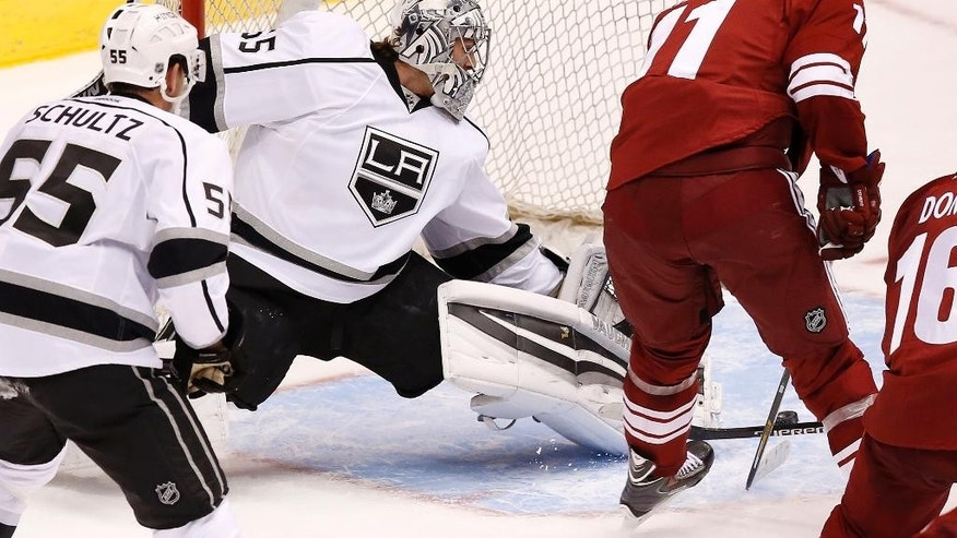 Arizona Coyotes' Martin Hanzal, right, scores a goal against Los Angeles Kings' Peter Bartosak, middle, as Kings' Jeff Schultz (55) looks on during the second period of a preseason NHL hockey game Monday, Sept. 22, 2014, in Glendale, Ariz. (AP Photo/Ross D. Franklin)