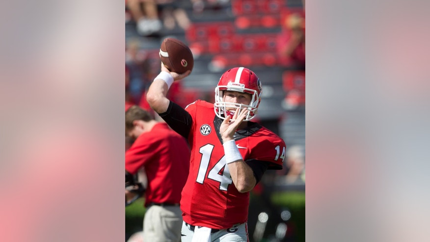 Georgia quarterback Hutson Mason warms up for an NCAA college football game against Troy Saturday, Sept. 20, 2014, in Athens, Ga. (AP Photo/John Bazemore)