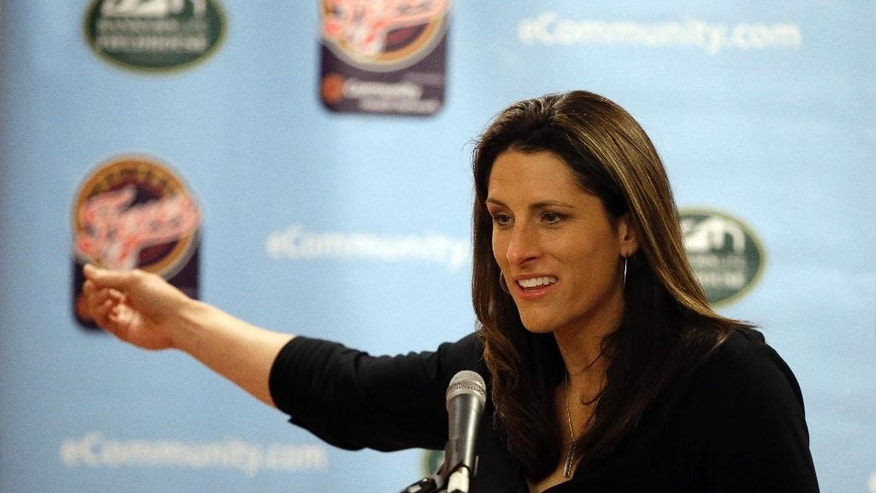 Indiana Fever head coach Stephanie White responds to a question during a news conference Tuesday, Sept. 23, 2014, in Indianapolis. White was formally introduced as the new head coach of the Fever. (AP Photo/Darron Cummings)