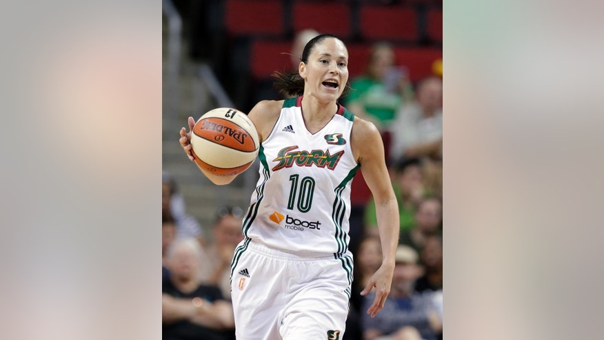 FILE - In this Thursday, July 31, 2014 file photo, Seattle Storm's Sue Bird plays against the Indiana Fever in a WNBA basketball game in Seattle. Bird became the first American player to make four world championship teams when USA Basketball announced the roster on Tuesday, Sept. 23, 2014. Bird won gold medals in 2002 and 2010 and a bronze medal in 2006.  (AP Photo/Elaine Thompson, File)