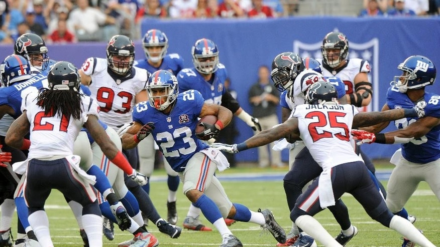 New York Giants running back Rashad Jennings (23) runs the ball against the Houston Texans in the fourth quarter of an NFL football game, Sunday, Sept. 21, 2014, in East Rutherford, N.J. (AP Photo/Bill Kostroun)