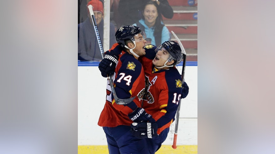 Florida Panthers defenseman Shane O'Brien (74) and Florida Panthers right wing Scottie Upshall (19) celebrate O'Brien's goal against the Dallas Stars in the second period of an NHL hockey preseason game, in Sunrise, Fla., Wednesday, Sept. 24, 2014. (AP Photo/Alan Diaz)