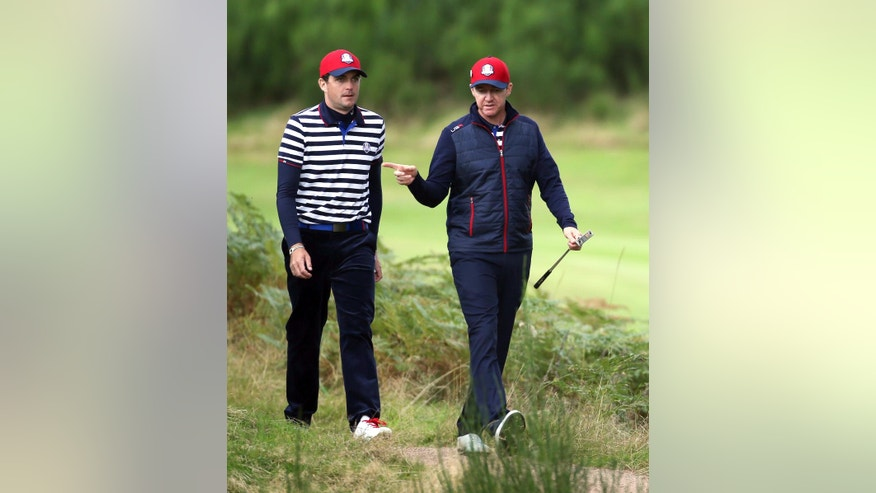 Keegan Bradley, left, and Jimmy Walker, of the US, walk to the 6th green during a practice round ahead of the Ryder Cup golf tournament at Gleneagles, Scotland, Wednesday, Sept. 24, 2014. (AP Photo/Scott Heppell)
