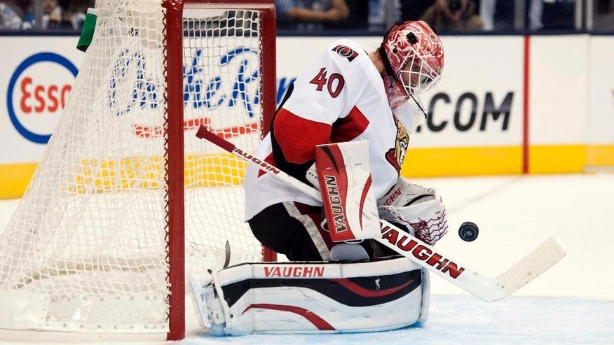 Ottawa Senators goalie Robin Lehner stops a shot by the Toronto Maple Leafs during the first period of an NHL preseason hockey game Wednesday, Sept. 24, 2014, in Toronto. (AP Photo/The Canadian Press, Hannah Yoon)