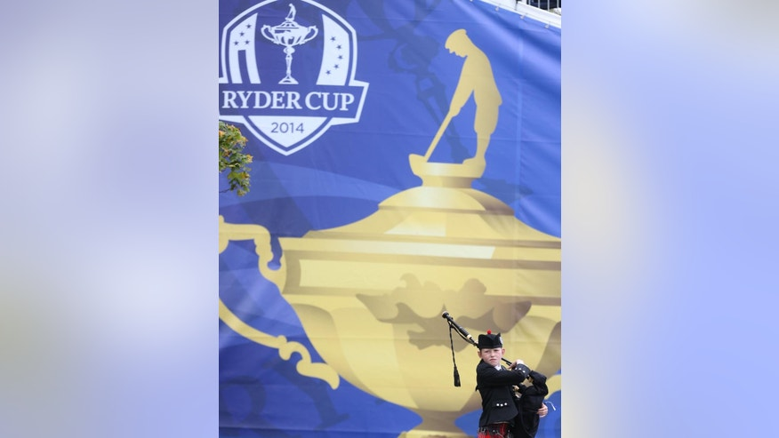 A piper from the Community School of  Auchterarder attends a practice day ahead of the Ryder Cup golf tournament at Gleneagles, Scotland, Wednesday, Sept. 24, 2014. (AP Photo/Peter Morrison)