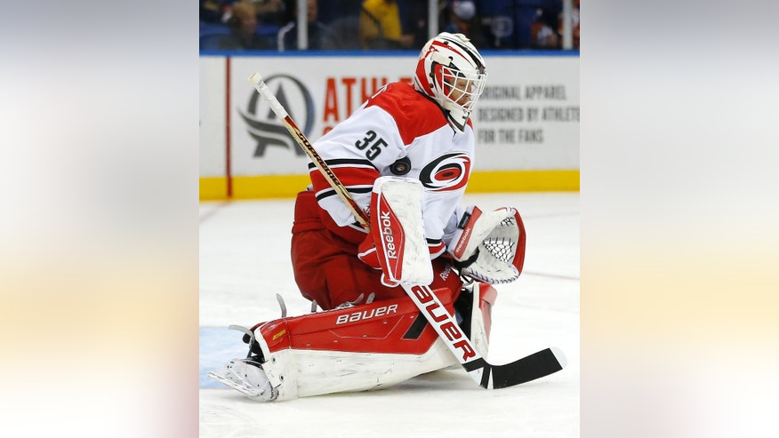 Carolina Hurricanes goalie Drew MacIntyre (35) makes a save during the second period of a preseason NHL hockey game against the New York Islanders on Wednesday, Sept. 24, 2014, in Uniondale, N.Y. The Hurricanes won 4-2. (AP Photo/Paul Bereswill)