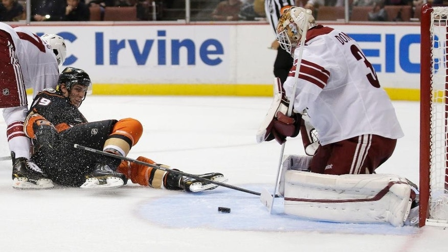 Arizona Coyotes goalie Louis Domingue, right, blocks a shot by Anaheim Ducks center Antoine Laganiere during the second period of an NHL hockey preseason game in Anaheim, Calif., Tuesday, Sept. 23, 2014. (AP Photo/Chris Carlson)