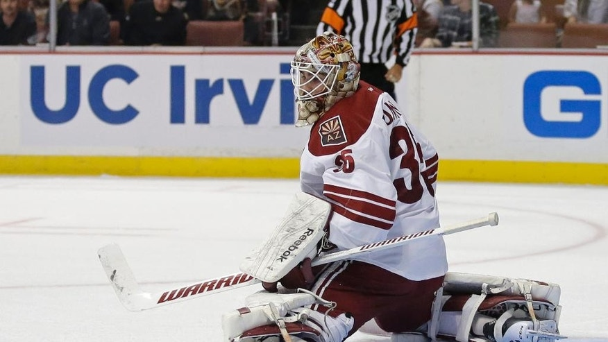 Arizona Coyotes goalie Louis Domingue deflects a shot during the second period of an NHL hockey preseason game against the Anaheim Ducks in Anaheim, Calif., Tuesday, Sept. 23, 2014. (AP Photo/Chris Carlson)