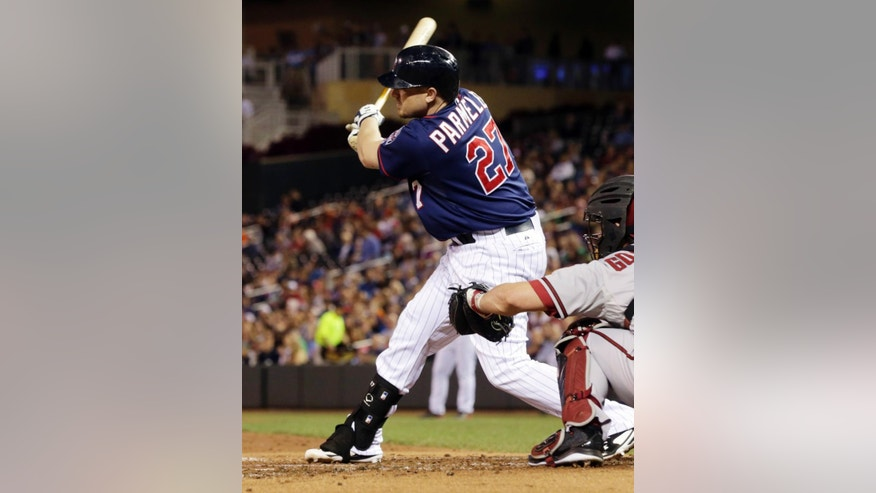 Minnesota Twins' Chris Parmelee hits a two-run single off Arizona Diamondbacks pitcher Andrew Chafin in the second inning of a baseball game, Tuesday, Sept. 23, 2014, in Minneapolis. (AP Photo/Jim Mone)