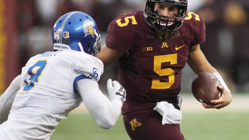 Minnesota quarterback Chris Streveler (5) runs against San Jose State cornerback Jimmy Pruitt (8) in the third quarter during their NCAA college football game on Saturday, Sept. 20, 2014 in Minneapolis. (AP Photo/Andy Clayton-King)