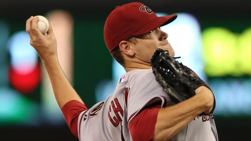 Minnesota Twins pitcher Phil Hughes throws against the Arizona Diamondbacks  in the first inning of a baseball game, Wednesday, Sept. 24, 2014, in Minneapolis. (AP Photo/Jim Mone)
