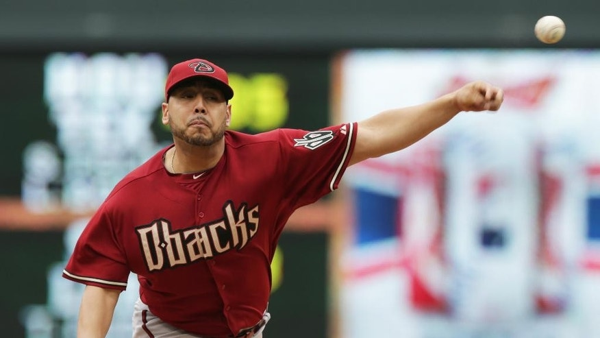 Arizona Diamondbacks' pitcher Vidal Nuno throws against the Minnesota Twins in the first inning of a baseball game, Wednesday, Sept. 24, 2014, in Minneapolis. (AP Photo/Jim Mone)