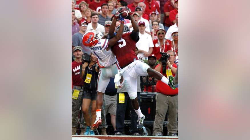 Alabama wide receiver Amari Cooper (9) catches a pass over the top of Florida defensive back Vernon Hargreaves III (1) for a touchdown during the second half of an NCAA college football game on Saturday, Sept. 20, 2014, in Tuscaloosa, Ala. (AP Photo/Butch Dill)