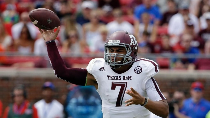 Texas A&M quarterback Kenny Hill (7) passes against SMU in the first half of an NCAA college football game,  Saturday, Sept. 20, 2014, in Dallas. (AP Photo/Tony Gutierrez)