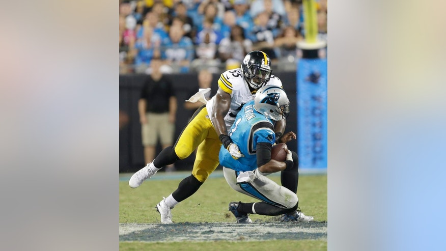 FILE- In this Sept. 21, 2014, file photo, Pittsburgh Steelers linebacker Arthur Moats (55) sacks Carolina Panthers' Cam Newton (1) during the second half of an NFL football game in Charlotte, N.C. The Steelers young linebacker corps is hobbled, giving Moats a chance to play more. (AP Photo/Bob Leverone, File)