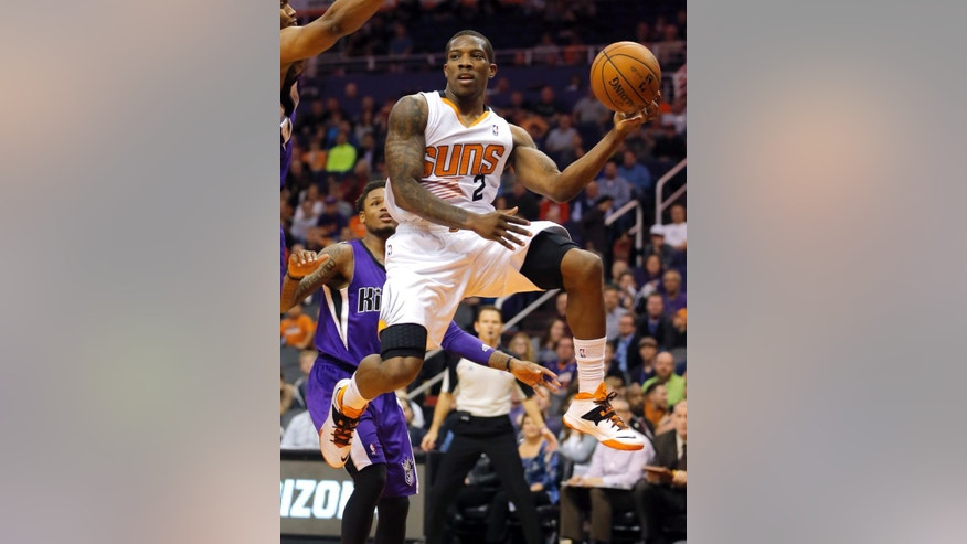 FILE - In this Dec. 13, 2013, file photo, Phoenix Suns' Eric Bledsoe (2) passes against the Sacramento Kings during an NBA basketball game in Phoenix. A person with knowledge of the deal says the Suns and Bledsoe have reached agreement on a five-year, $70 million contract. The person spoke Wednesday, Sept. 24, 2014, on condition of anonymity because the agreement has not been officially announced. (AP Photo/Matt York, File)