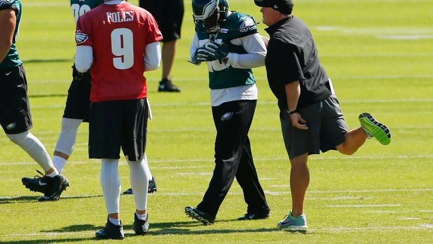 Philadelphia Eagles head coach Chip Kelly gestures as running back LeSean McCoy, center, walks by as quarterback Nick Foles (9) looks on during NFL football practice at the team's training facility, Tuesday, Sept. 23, 2014, in Philadelphia. (AP Photo/Matt Rourke)