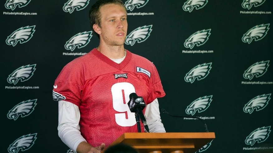 Philadelphia Eagles quarterback Nick Foles speaks to members of the media after NFL football practice at the team's training facility, Tuesday, Sept. 23, 2014, in Philadelphia. (AP Photo/Matt Rourke)