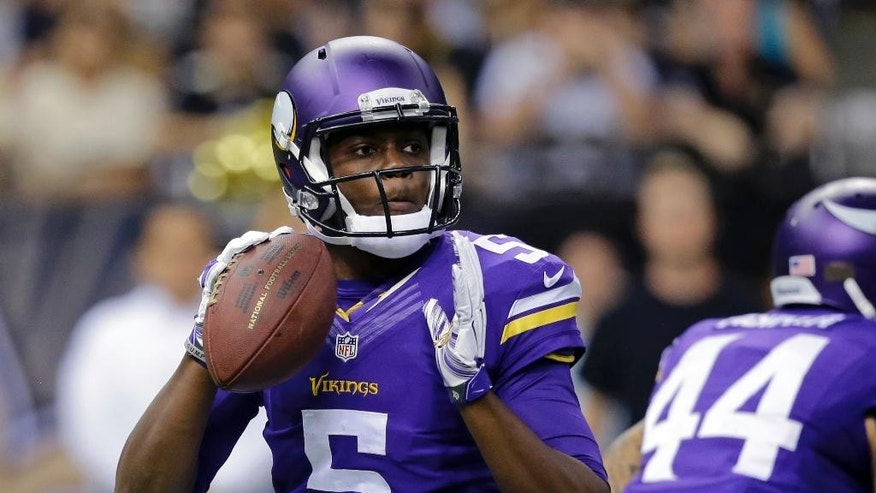 Minnesota Vikings quarterback Teddy Bridgewater (5) drops back to pass in the first half of an NFL football game against the New Orleans Saints in New Orleans, Sunday, Sept. 21, 2014. (AP Photo/Bill Haber)