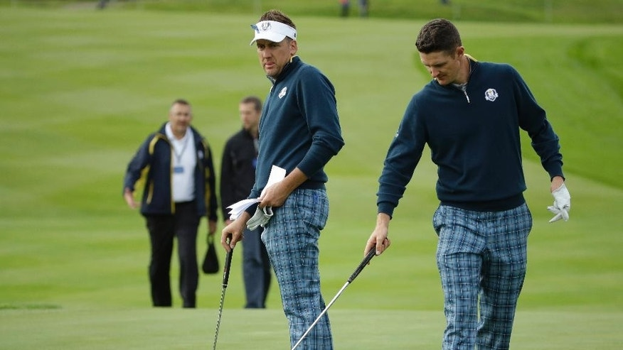 Europe's Ian Poulter, left, and Justin Rose prepare to putt on the 15th green during a practice round ahead of the Ryder Cup golf tournament, at Gleneagles, Scotland, Tuesday, Sept. 23, 2014. (AP Photo/Matt Dunham)