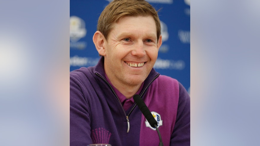Europe's Stephen Gallacher smiles during a press conference ahead of the Ryder Cup golf tournament at Gleneagles, Scotland, Wednesday, Sept. 24, 2014. (AP Photo/Matt Dunham)