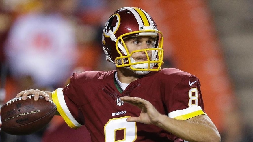 Washington Redskins quarterback Kirk Cousins warms up before an NFL football game against the New York Giants in Landover, Md., Thursday, Sept. 25, 2014. (AP Photo/Patrick Semansky)