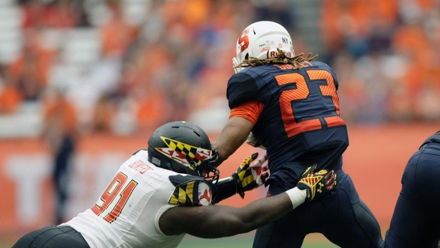 Maryland's Keith Bowers, left, takes down Syracuse's Tyson Prince-Gulley in the fourth quarter of an NCAA college football game against at the Carrier Dome in Syracuse, N.Y., Saturday, Sept. 20, 2014. Maryland won 34-20. (AP Photo/Nick Lisi)