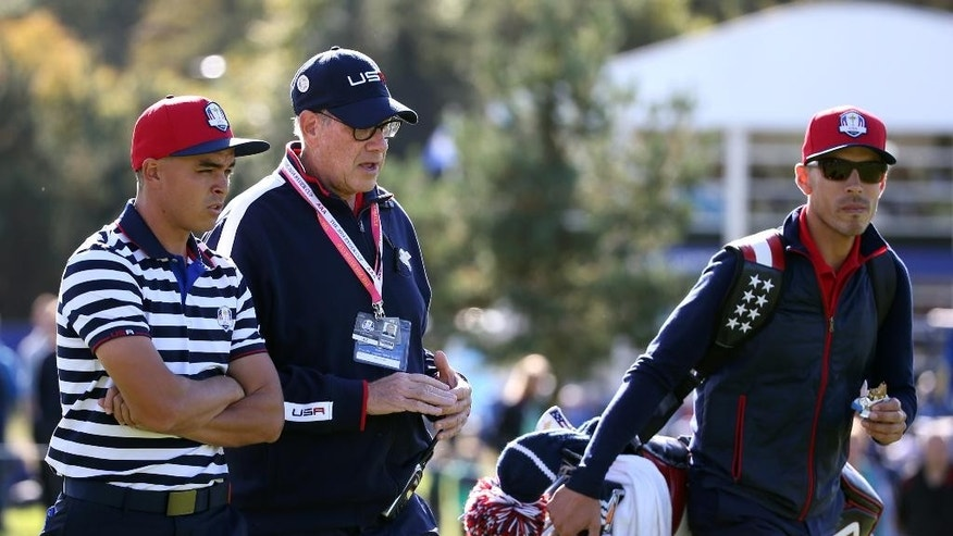Rickie Fowler of the US, left, walks with Neil Oxman, former caddie of US team captain Tom Watson, during a practice round ahead of the Ryder Cup golf tournament at Gleneagles, Scotland, Wednesday, Sept. 24, 2014. (AP Photo/Scott Heppell)