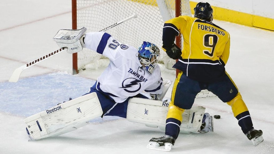 Nashville Predators center Filip Forsberg (9), of Sweden, scores against Tampa Bay Lightning goalie Kristers Gudlevskis (50) in the first period of a preseason NHL hockey game Thursday, Sept. 25, 2014, in Nashville, Tenn. (AP Photo/Mark Humphrey)