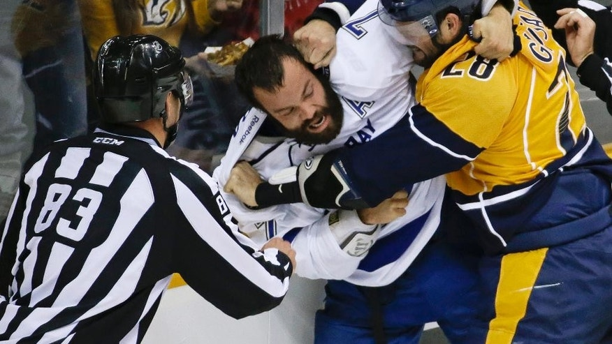 Nashville Predators center Paul Gaustad (28) fights with Tampa Bay Lightning defenseman Radko Gudas (7) in the first period of a preseason NHL hockey game Thursday, Sept. 25, 2014, in Nashville, Tenn. (AP Photo/Mark Humphrey)