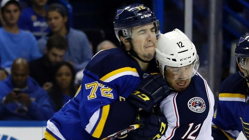 Columbus Blue Jackets' Ryan Craig, right, is checked by St. Louis Blues' Cody Beach during the first period of a preseason NHL hockey game Thursday, Sept. 25, 2014, in St. Louis. (AP Photo/Jeff Roberson)