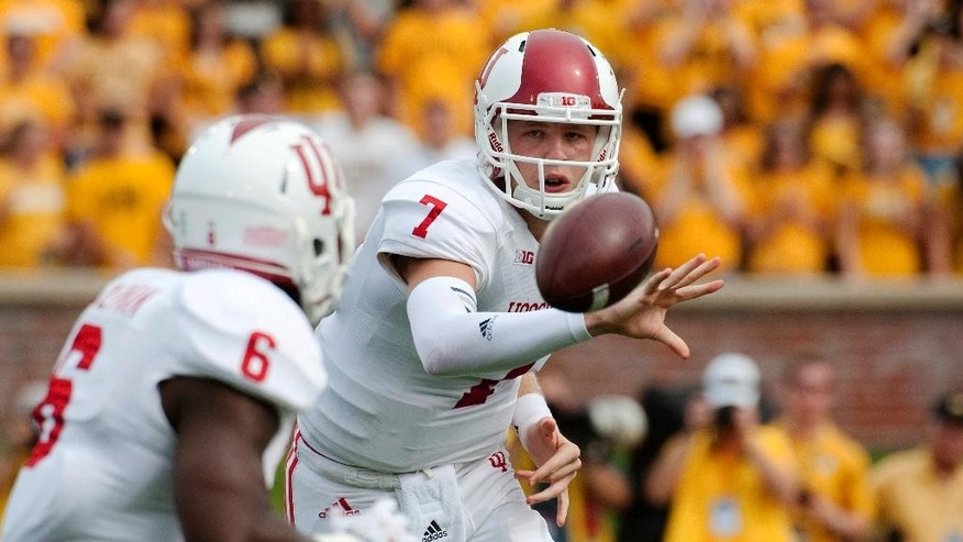 Indiana quarterback Nate Sudfeld, right, laterals the ball to running back Tevin Coleman during the first quarter of an NCAA college football game against Missouri, Saturday, Sept. 20, 2014, in Columbia, Mo. (AP Photo/L.G. Patterson)